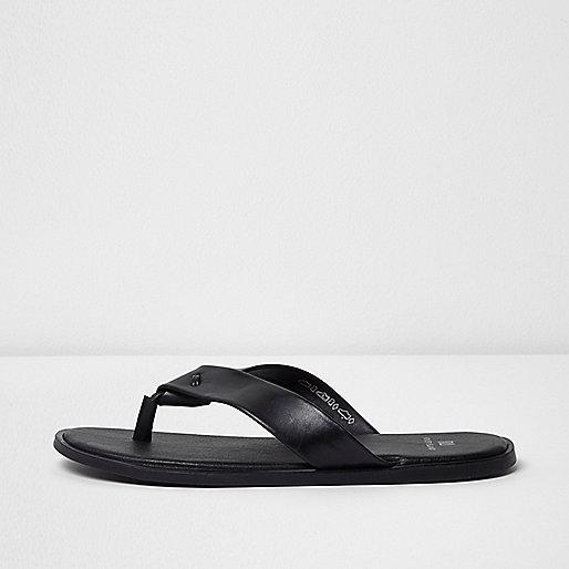 Black leather flip flops