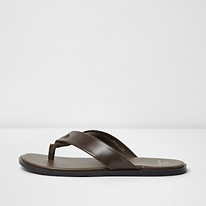Brown leather flip flops