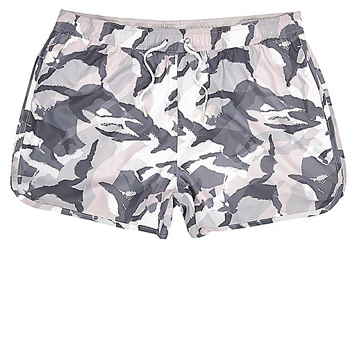 Pink runner style camo print swim trunks