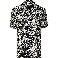 Blue jungle print short sleeve shirt