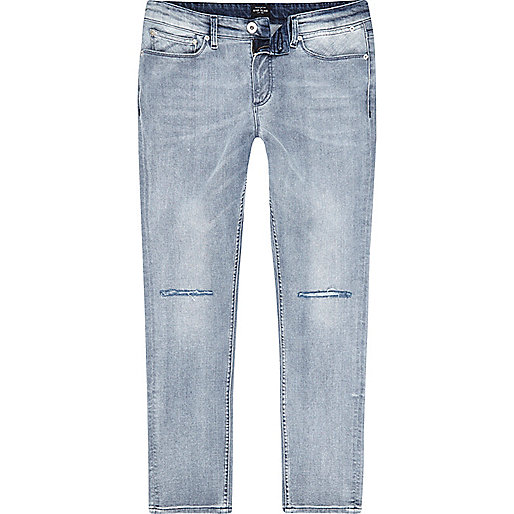 Light blue ripped knee wash skinny Sid jeans
