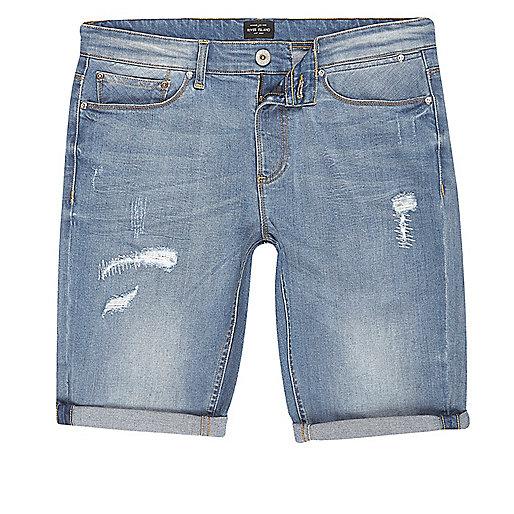 Blue wash distressed skinny fit denim shorts