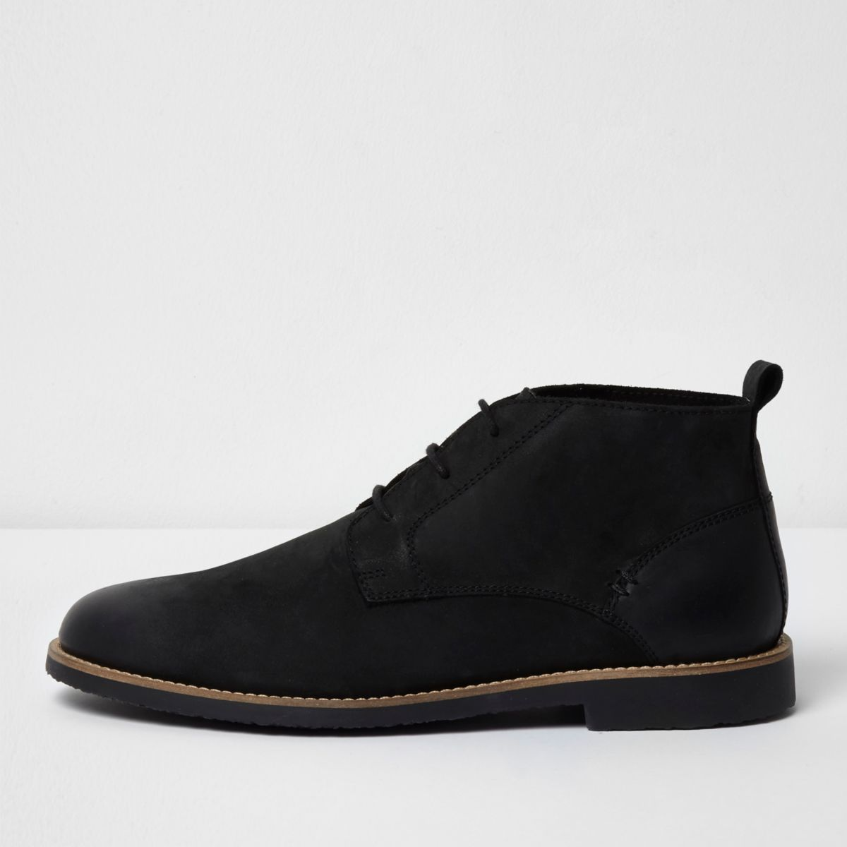 Black leather desert boots