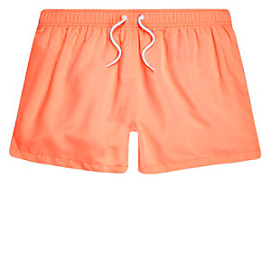 Orange coral swim trunks