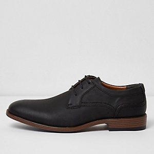 Black embossed formal shoes