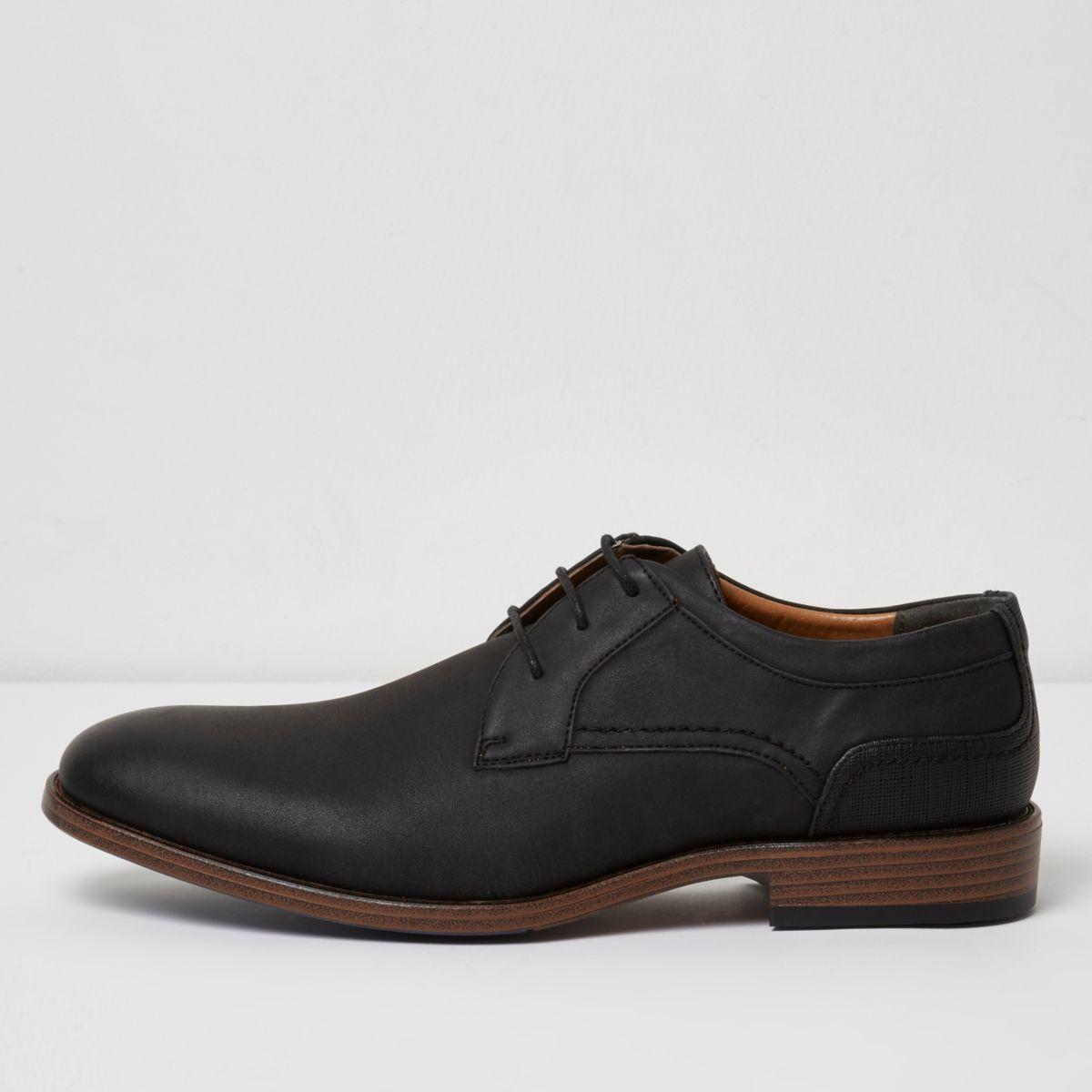 Black embossed formal shoes