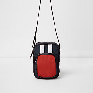 Red colour block cross body flight bag