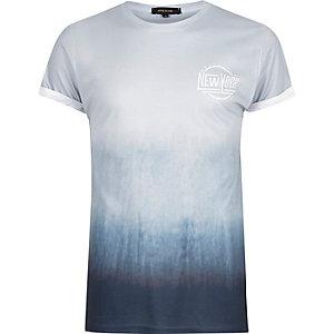 Blauw T-shirt met kleurverloop en slogan