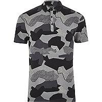 Polo ajusté imprimé camouflage abstrait noir