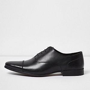 Schwarze Oxford-Schuhe aus Leder
