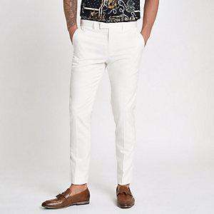 Pantalon de costume skinny blanc avec bordures en satin