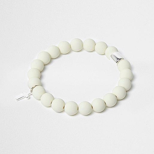 White beaded cross bracelet
