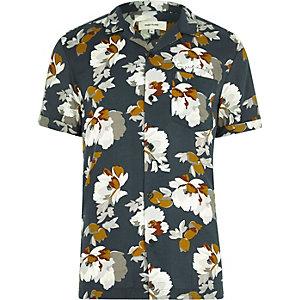 Chemise à fleurs bleu marine à manches courtes et col à revers