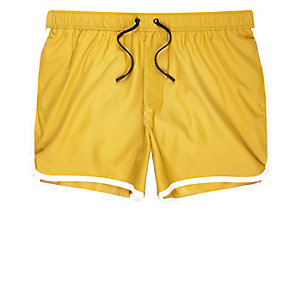 Yellow short swim trunks