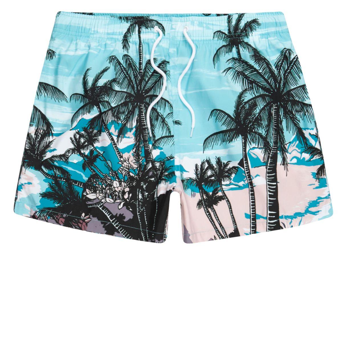 Blue palm tree beach scene print swim trunks