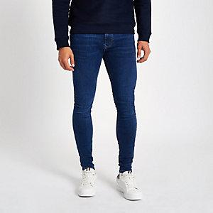 Jean super skinny bleu foncé délavé irrégulièrement