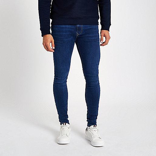 Dark blue wash super skinny spray on jeans