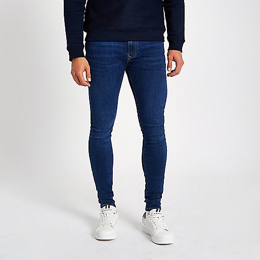 Dark blue wash super skinny spray on jeans