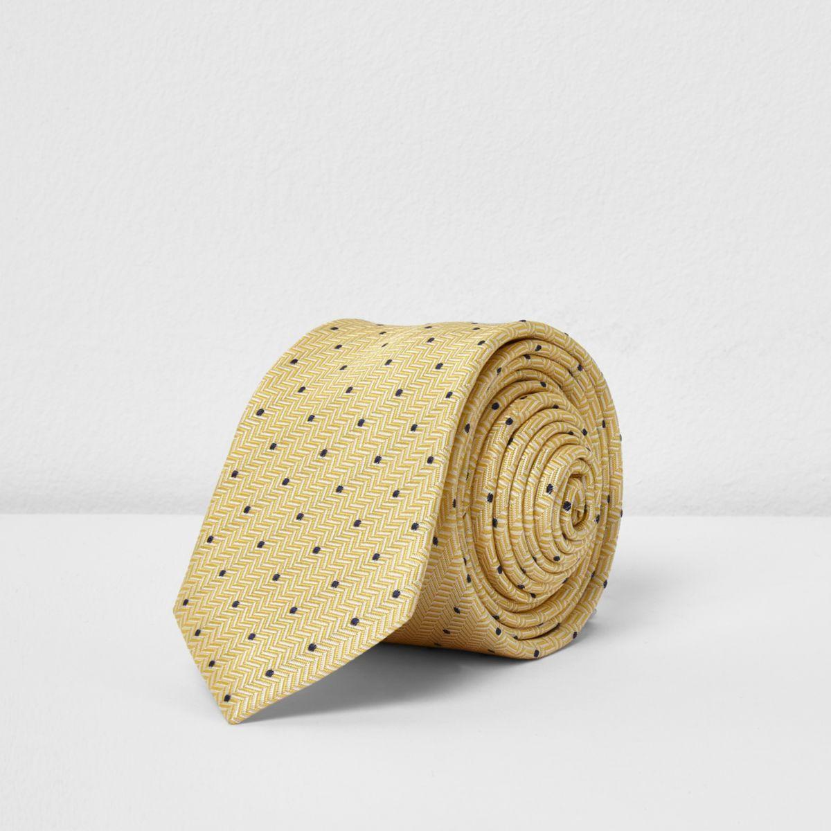 Cravate à pois jaune