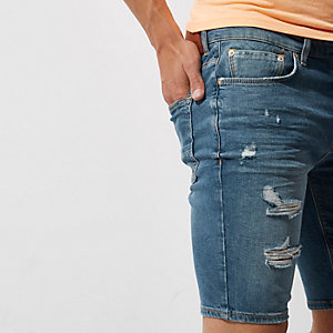 Mid blue ripped skinny denim shorts
