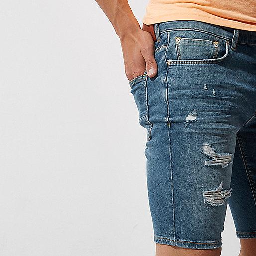 Mid blue ripped skinny denim shorts