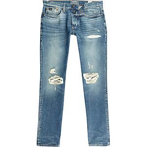 Blue ripped Sid skinny stretch warp jeans
