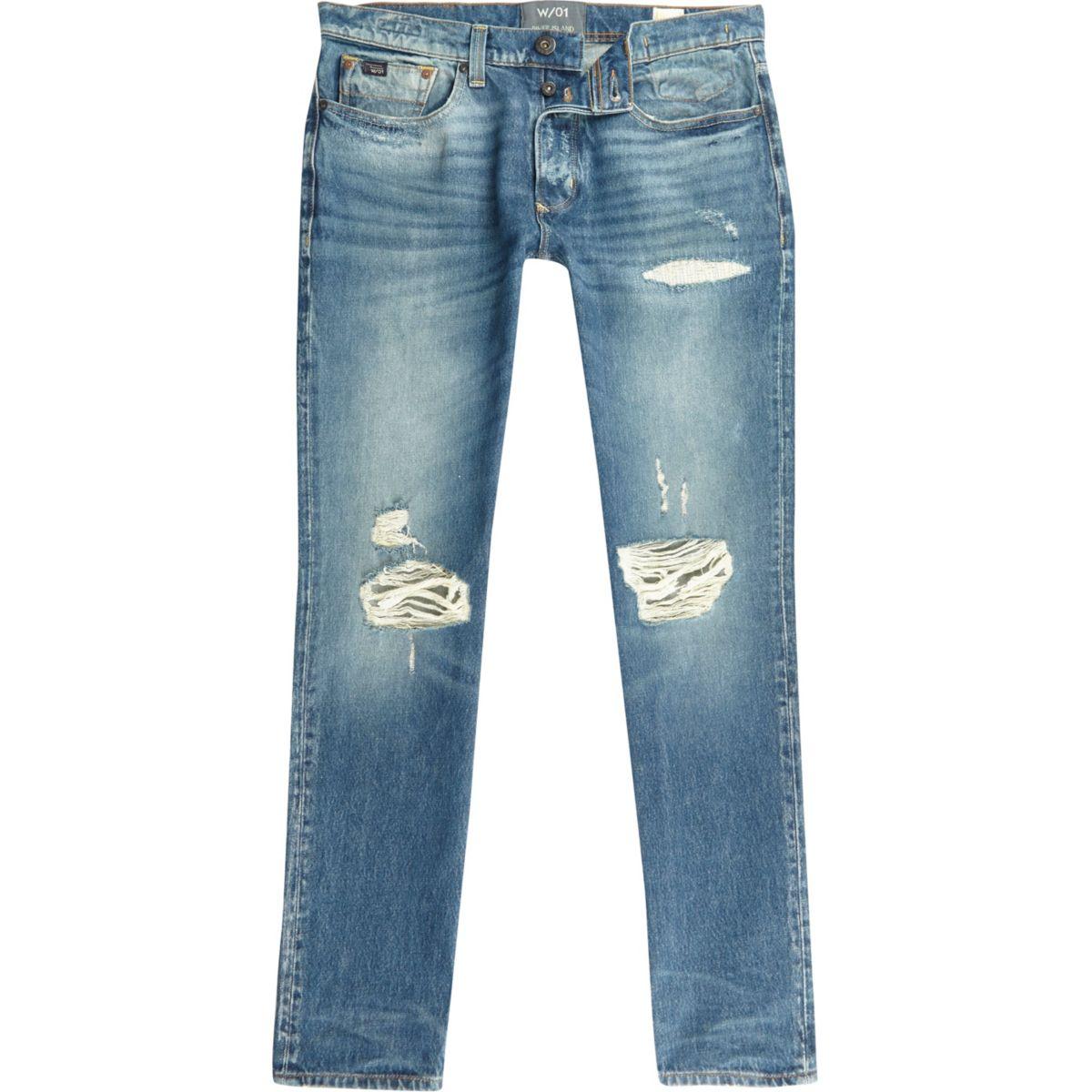Blue ripped Sid skinny warp jeans
