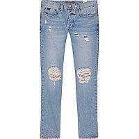 Light blue wash ripped Sid skinny warp jeans