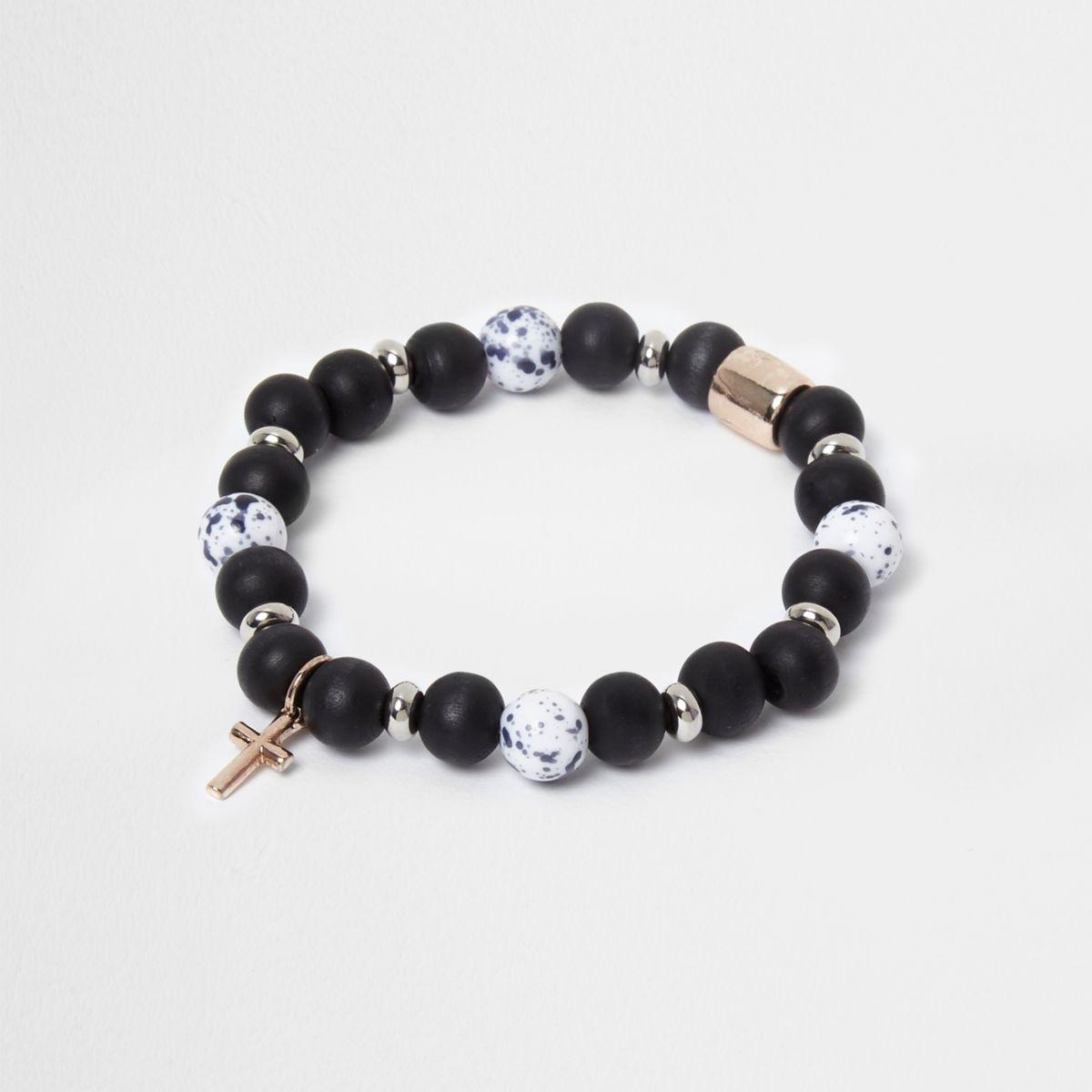 Bracelet avec perles bleues et croix