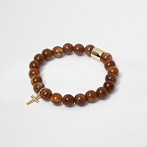 Bracelet avec perles marron et croix