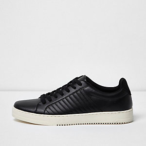 Black quilted lace-up sneakers