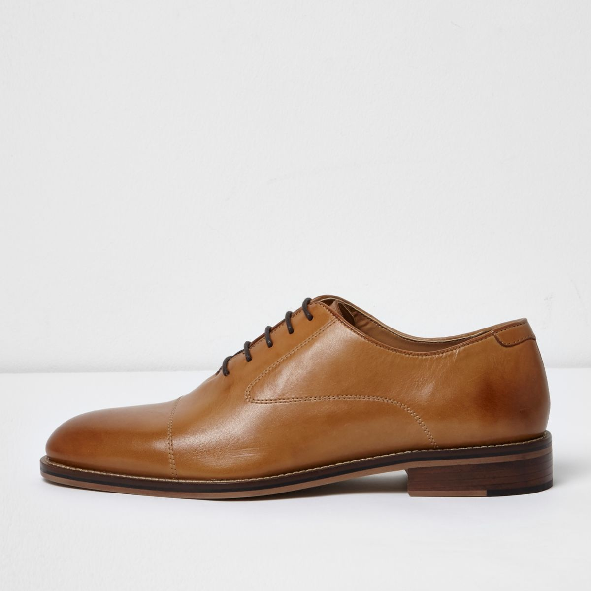 Tan lace-up Oxford shoes