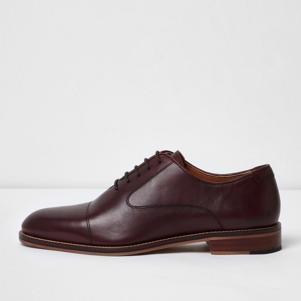 Dark red lace-up Oxford shoes