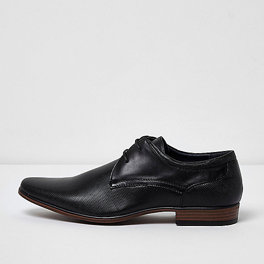 Black perforated formal shoes