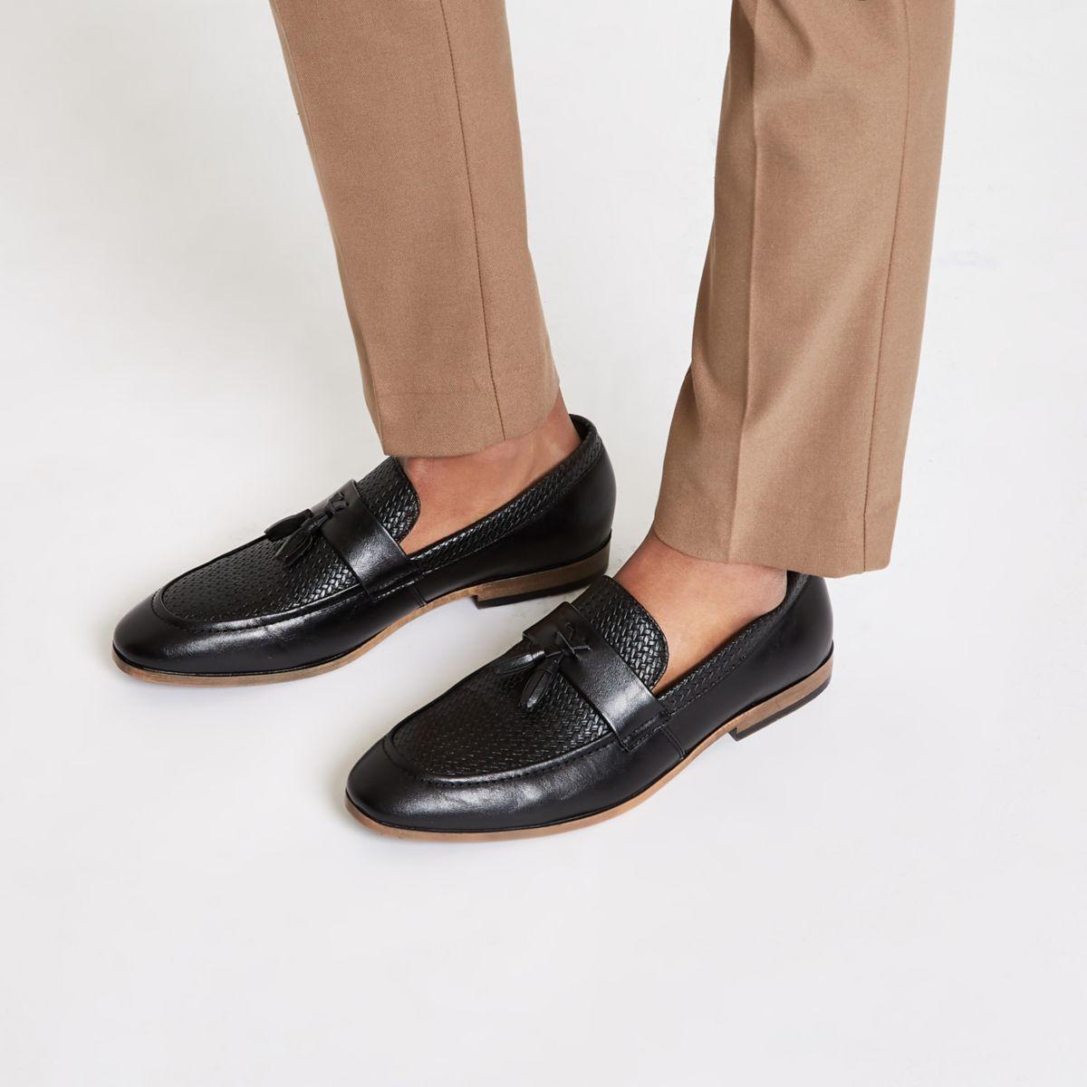 Black tassel woven loafers