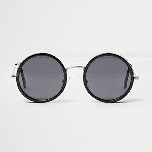 Zwarte ronde zonnebril met uitsnede