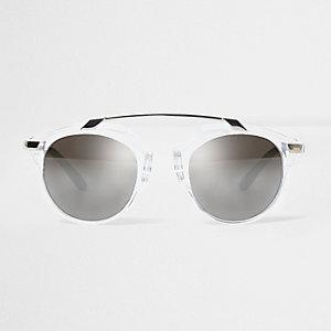 Doorzichtige ronde zonnebril met wenkbrauwbalk en zilverkleurige glazen
