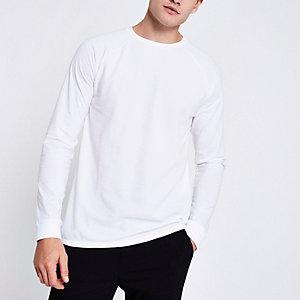 Wit T-shirt met lange raglanmouwen en wafeldessin