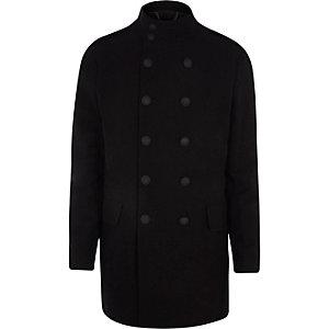 Zwarte jas met dubbele rij knopen en opstaande kraag