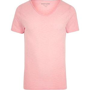 Roze aansluitend T-shirt met lage hals