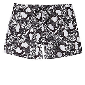 Black mono butterfly print swim trunks