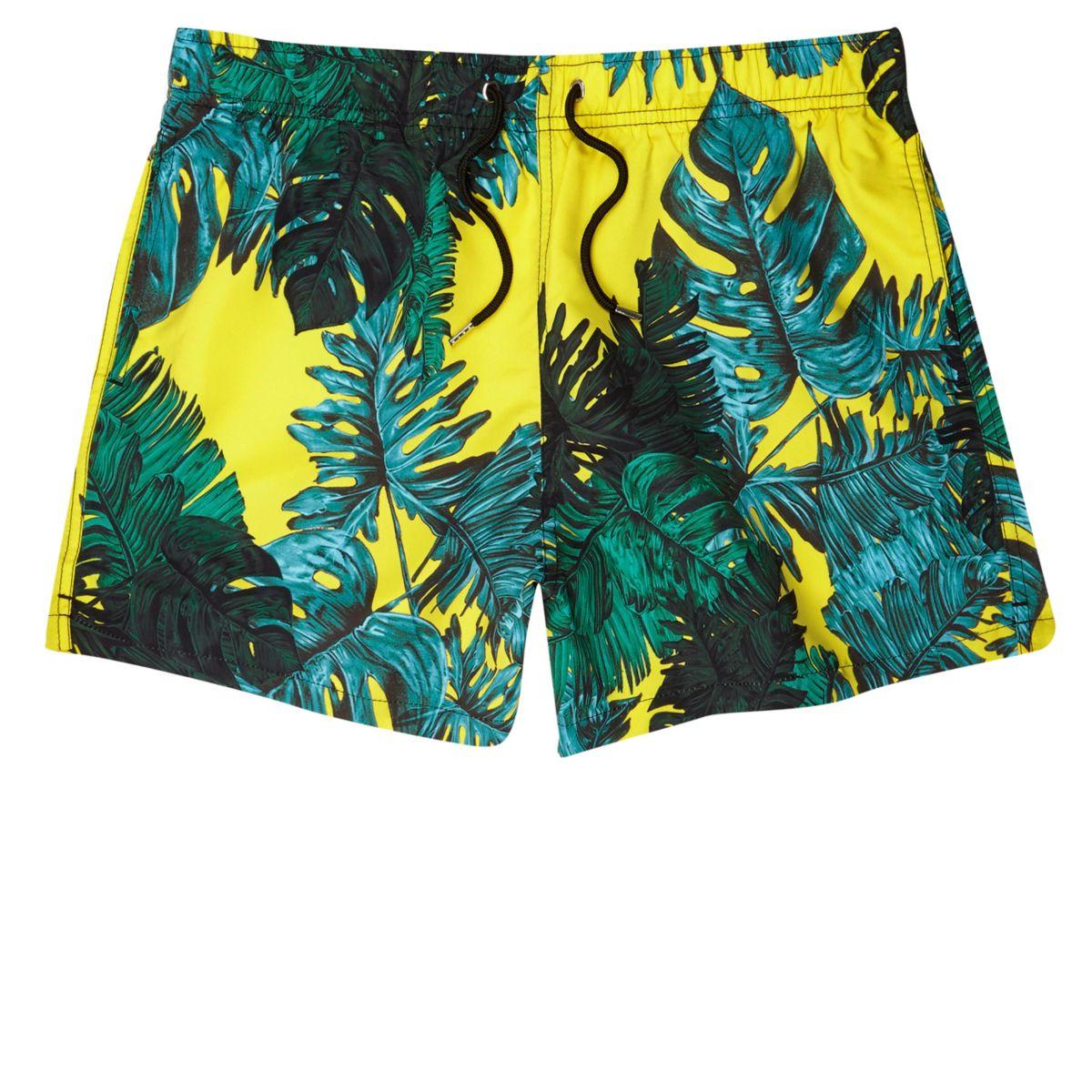 Yellow palm leaf print swim trunks