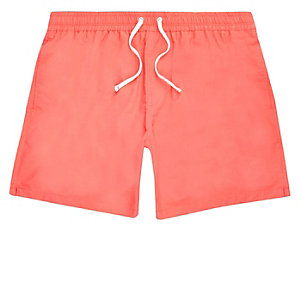 Coral swim trunks