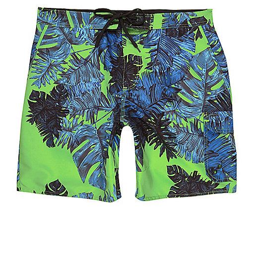 Green palm print swim trunks