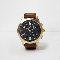 Tan strap gold tone round face watch