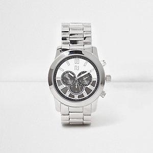 Horloge met ronde wijzerplaat en zilverkleurig kettingbandje