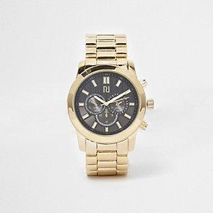 Montre à cadran noir avec bracelet à maillons dorés