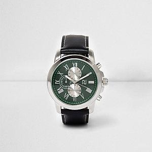 Horloge met groene wijzerplaat en zwart bandje in leerlook