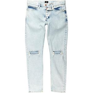 Lichtblauwe skinny jeans met gescheurde knie