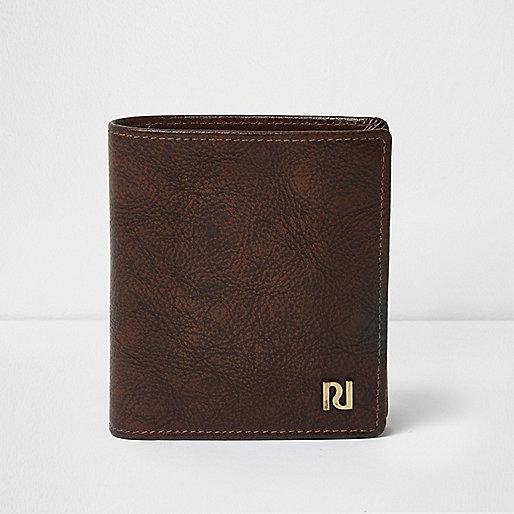 Antique tan leather wallet